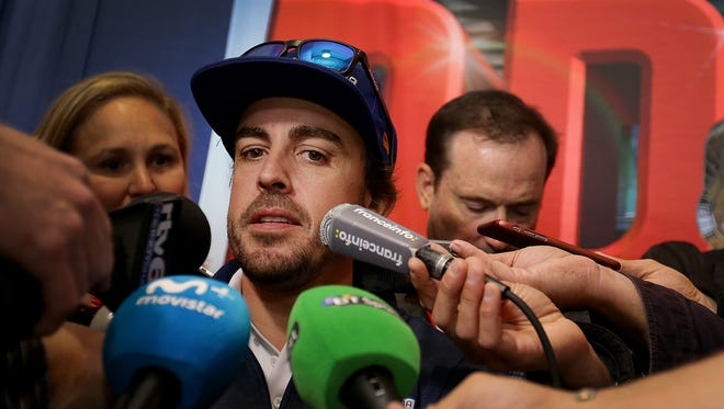 McLaren-Honda-Andretti IndyCar driver Fernando Alonso (29) fields questions from reporters during media day for the drivers of the 101st Indianapolis 500 Thursday, May 25, 2017, afternoon at the Indianapolis Motor Speedway.