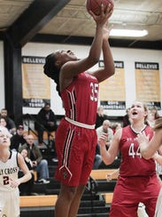 Chisom Iloegbunam of St. Henry goes under the basket