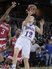 Courtney Hurst of Conner finishes a drive with a layup.