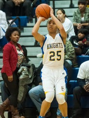 Sussex Central guard Taylor Pritchett (25) takes a
