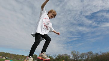 """Isabella DeBucco, 7, from Stony Point runs an obsticle course at the second annual """"Sports Day for Charity"""" event at North Rockland High School in Thiells on Saturday, April 30, 2016."""