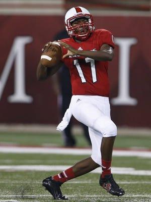 LaSalle High School's Nick Watson, 17 throws on the run.
