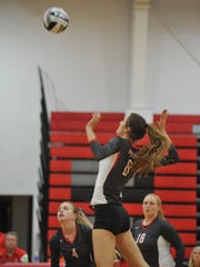 Lexi Evak winds up to hit the ball against Crestline