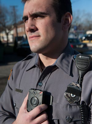 Patrolman Jim Gentile, with the Paulsboro Police Department, wears a body camera that records interactions with citizens. The department is the first in the county to get body cameras for its officers.