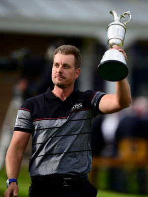 Stenson holds the Claret Jug  after the final round.