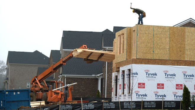 Construction workers build a new home at the Whittmore subdivision off Rocky Fork Road in Nolensville. Nolensville has grown so much since completing its special census in 2015 that it's considering doing it again.