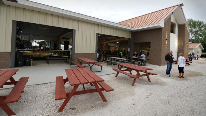 Structural beams from the original shelter were recycled into the new building at Okauchee Lions Park that is to be enclosed for extended season use and expanded with utility storage, meetings rooms and restrooms.