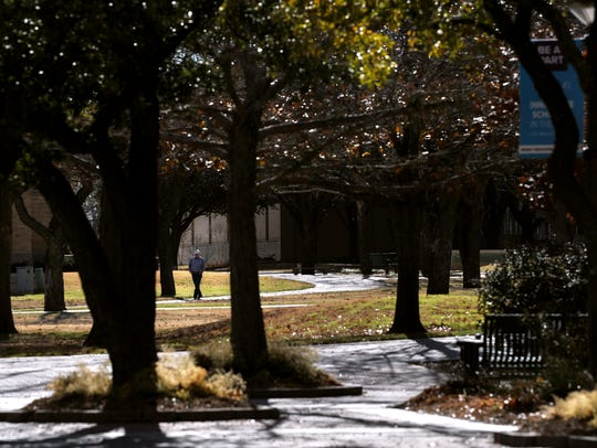 A man walks across the Abilene Christian University Campus Wednesday. Classes for the spring semester start Tuesday.
