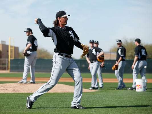 FILE - In this Saturday, Feb. 21, 2015, file photo, Chicago White Sox's Jeff Samardzija throws during a spring training baseball workout in Phoenix. This time last year, the White Sox welcomed the start of spring training with visions of a playoff run after a busy offseason they thought would vault them toward the top of the AL Central. Instead, they fizzled. Now, they vow to make it happen. (AP Photo/John Locher, File)