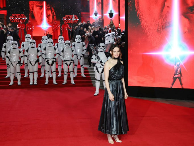 Actress Daisy Ridley poses for photographers upon arrival