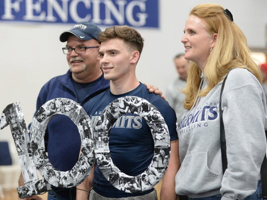 St. Augustine's Steven Schwab poses for a photo with his parents after winning his 100th bout after pinning Delsea's Xavier Mullins in the 132-lb bout during Saturday's wrestling match at St. Augustine.  01.27.18.
