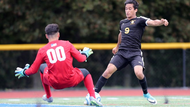 Damien Parker, of Bergen County Tech, is shown just before crashing into Passaic County Technical Institute goalie, Angel Sanchez.  It is believed Parker suffered a broken leg.  The game was continued after a 40 minute game delay, as paramedics were called to help Parker off the field.  Tuesday, September 19, 2017