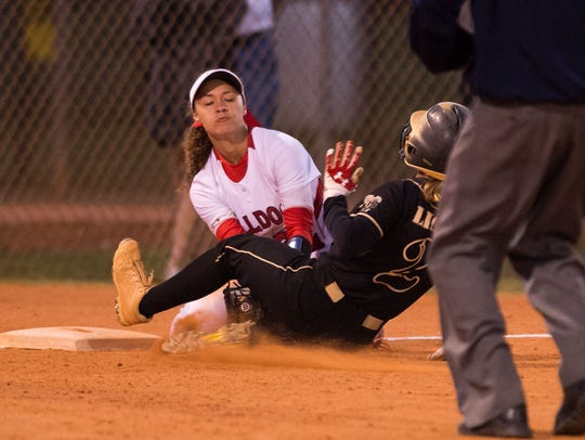 South Fork's Malea Rolle, at third base, catches the