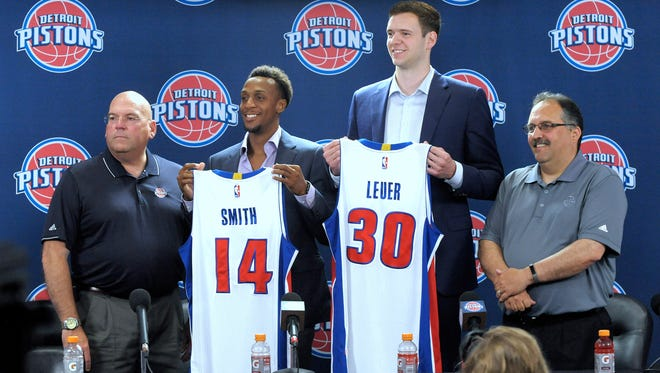 Detroit Pistons GM Jeff Bower, players Ish Smith and Jon Leuer and head coach Stan Van Gundy pose for a portrait after the news conference July 8 at The Palace of Auburn Hills.