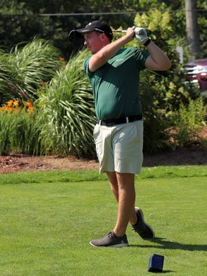 Andrew Johnson, the leader at the halfway mark of the 84th annual GMGC club championship, watches his drive down the middle of the fairway on the 17th hole during his round on Sunday.