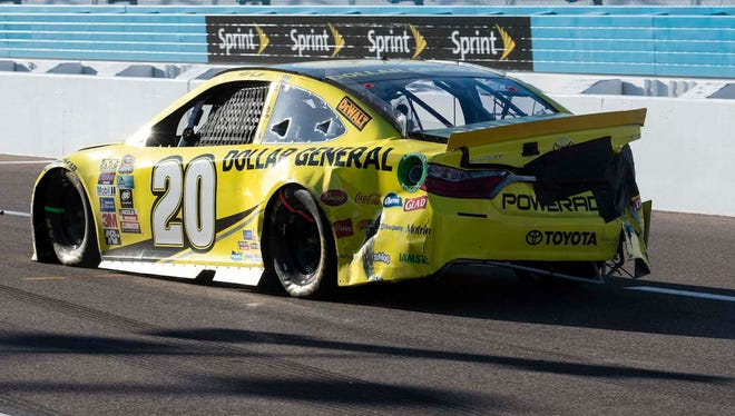 Matt Kenseth  drives down pit row after wrecking at end of the Can-Am 500 at Phoenix International Raceway.