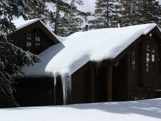 A snow laden roof is seen on a private home at Kirkwood Mountain Resort in California on March 23, 2018.