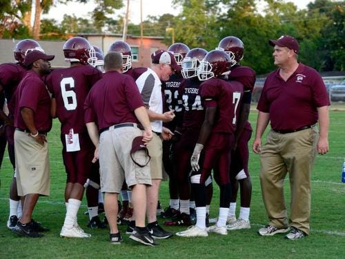 PHS coach Mike Mincy, right, and the Tigers are in a must-win situation this Friday vs. Mosley.