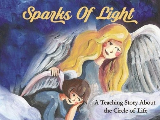 """Sparks of Light"" by Christine Word, of Lafayette, uses two angels to ""reveal the truth about who we are and what we're doing in this life."""