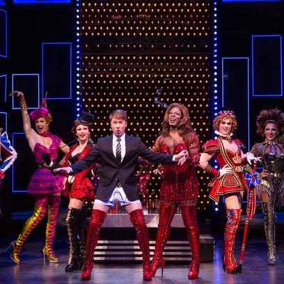 "Steven Booth (at center in suit, tie and boots) plays shoe factory owner Charlie in Cyndi Lauper's ""Kinky Boots,"" continuing at the Peace Center through Sunday."