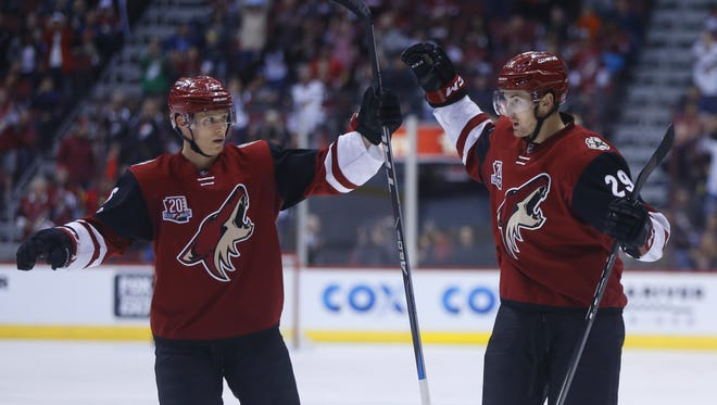 Coyotes' Brendan Perlini (29) celebrates a goal with teammate Jakob Chychrun (6) in the second period at Gila River Arena on March 11, 2017 in Glendale, Ariz.