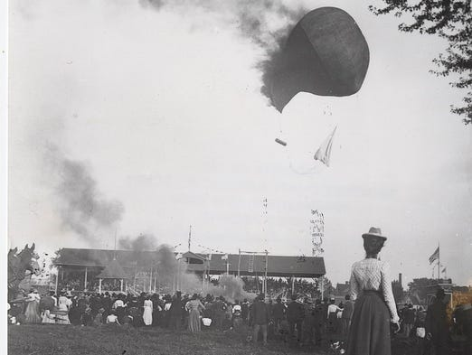 A balloon catches on fire over the fair at Stow Flats, about 1890.