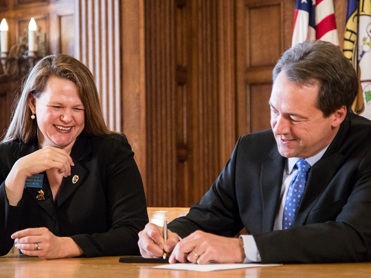 Gov. Steve Bullock signs one of four bills Monday to