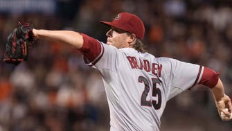 Apr 16, 2015: Arizona Diamondbacks starting pitcher Archie Bradley (25) throws a pitch against the San Francisco Giants during the sixth inning at AT&T Park.