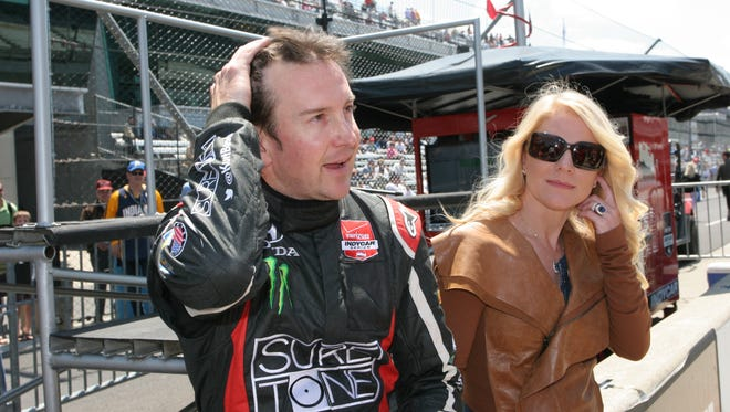 Kurt Busch and then-girlfriend Patricia Driscoll catch their breath in the pits at The Indianapolis Motor Speedway, May 18, 2014.