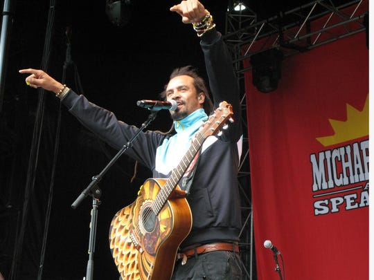 Michael Franti performs at the Mountain Jam music festival.