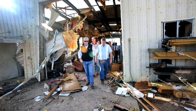 Mississippi Governor Phil Bryant inspects tornado storm damage to a MDOT facility in Ashland, Miss., Thursday, Dec. 24, 2015.