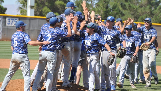 Western Nevada College baseball players celebrate their 9-7 victory against College of Southern Nevada in the Region 18 baseball tournament on Friday in Henderson.