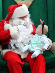 Six-month-old Zelda Spence visits Santa at Mister Ed's Candy Emporium and Elephant Museum on Sunday.
