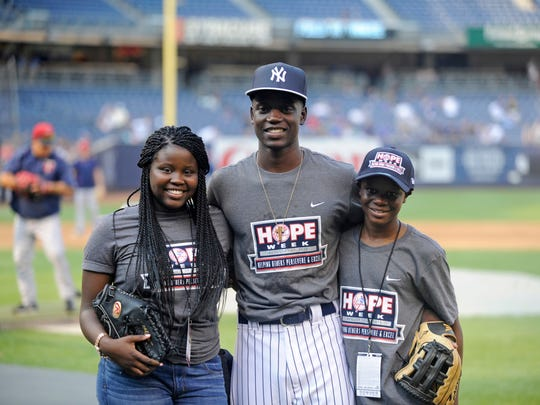 In this August 2017 file photo, Chris Singleton poses with sister Camryn, left, and brother Caleb, right, before the New York Yankees and Minnesota Twins baseball game at Yankee Stadium in New York. The Chicago Cubs drafted Chris Singleton.