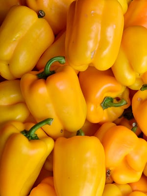 Yellow bell peppers wait to be bought at Donna's #6 Produce on Highway 49 south of Florence.