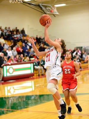 Abby Dornbusch drives to the basket Friday for Oak Harbor.