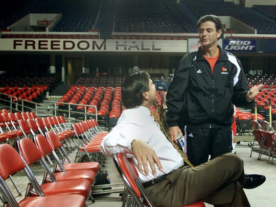 Rick Pitino chats with Tom Jurich at Freedom Hall in October 2001.