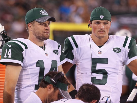 Former Penn State quarterback Christian Hackenberg (5) stands beside New York Jets starter Ryan Fitzpatrick during a preseason game. AP FILE PHOTO