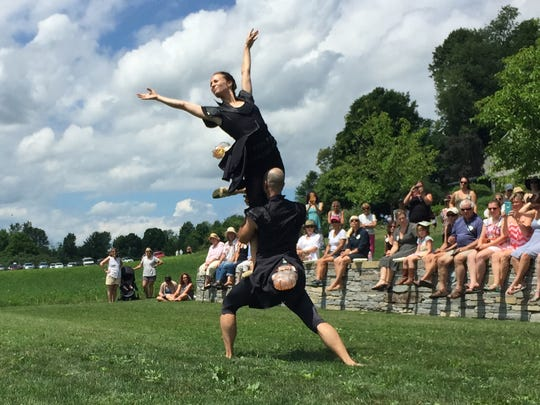 Dancers Megan Stearns and Chatch Pregger of Farm to Ballet enact a lightning-bug courtship Sunday at a performance in Hinesburg. The troupe was part of a garden tour fundraiser to benefit the Flynn Center for the Performing Arts in Burlington. Photographed Sunday, July 17, 2016.