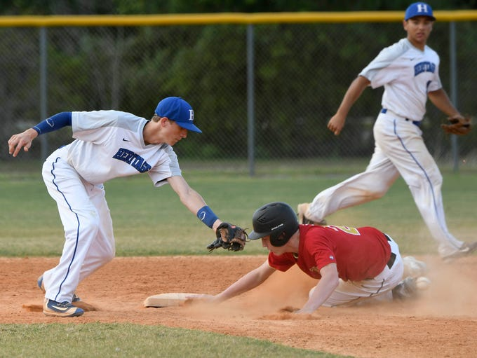 Austin Forbes of University successfully steals second