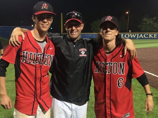 From left to right, Austin Metzger, Hilton coach Jeff
