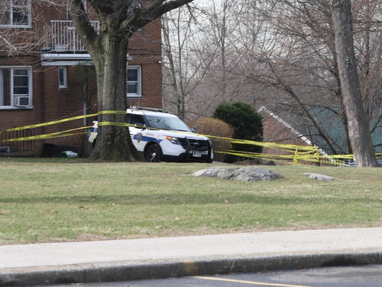 A Tarrytown police car and police tape are pictured in front of an apartment at the Sleepy Hollow Garden apartments at 177 White Plains Road in Tarrytown, Feb. 28, 2018.