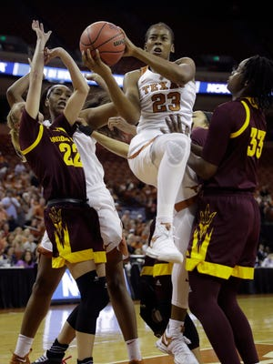 Texas guard Ariel Atkins (23) drives to the basket between Arizona State guard Courtney Ekmark (22) and center Charnea Johnson-Chapman (33) during a second-round game in the NCAA women's college basketball tournament, Monday, March 19, 2018, in Austin, Texas.