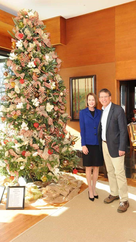 Then-first lady Ann McCrory and Gov. Pat McCrory stand by a Christmas tree at the Governor's Western Residence in 2016.
