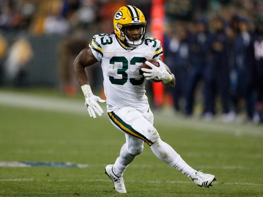 Green Bay Packers' Aaron Jones runs during the second