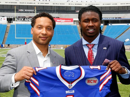 FILE- In this May 9, 2014, file photo, Buffalo Bills first-round draft pick Sammy Watkins, right, poses for photos with general manager Doug Whaley at Ralph Wilson Stadium in Orchard Park, N.Y.  Whaley's swing-for-the-fences philosophy is evident in the new-look offense the Bills will unveil Sunday, when they open training camp in suburban Rochester. There's rookie receiver Sammy Watkins, who was drafted fourth overall after Whaley traded Buffalo's 2015 first-round pick to Cleveland.  (AP Photo/Bill Wippert, File)