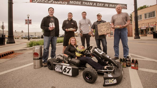 New-to-Speedway business owners and drivers gathered for a photo on Main Street Speedway, Wednesday, May 20, 2015. From left: Shane Pearson, owner of Daredevil Brewing Co.; Andy O'Gara, and his wife, Sarah Fisher (sitting), owners of SIK Speedway Indoor Karting; A.J. Foyt IV, co-owner of  Foyt Family Wines; and Ed Ryan and Jim Dunbar, owners of Big Woods Brewery.