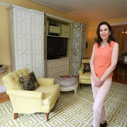 Interior designer Brittany Zachos with the dining room table in her Rye home July 7, 2015.