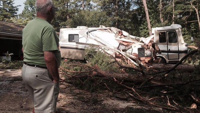 Bill Boyle's 36-foot RV, parked outside his home on Limerick Drive, was flattened Tuesday afternoon.
