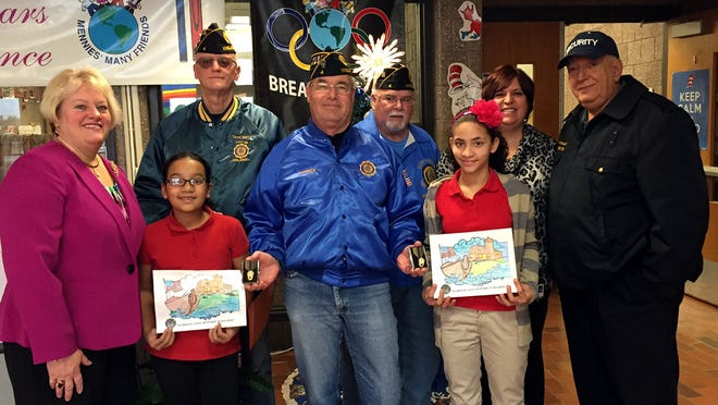 (From left) Mennies Elementary School Principal Lisa Arena, fourth-grader Amerie Guzman, American Legion Post No. 4 member Grant Connelly, post Commander Pat Sweeney, post member Bob Wolfe, fifth-grader Desiree Castro, Assistant Principal Kristen Speakman and post member John Provenzano. Desiree placed first and Amerie placed third in the post's coloring contest.